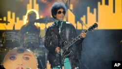 FILE - Prince performs at the Billboard Music Awards at the MGM Grand Garden Arena in Las Vegas.