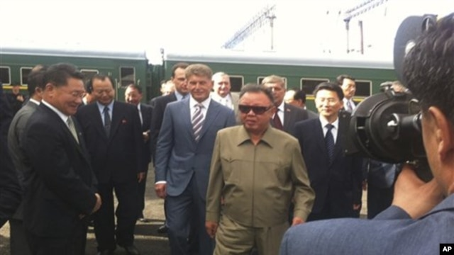 North Korean leader Kim Jong-il takes part in a welcoming ceremony on his arrival in Novoburesky in Amur province, August 21, 2011.