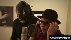 "Tiken Jah Fakoly and Salif Keita during recording of song/video, ""Africa Stop Ebola"". Photo Credit: Remi Crepeau"