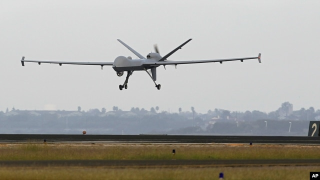 FILE - This Nov. 8, 2011 file photo shows a Predator B unmanned aircraft landing after a mission, at the Naval Air Station, in Corpus Christi, Texas.