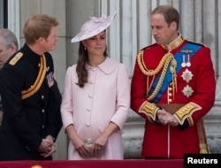 Prince Harry (L), Prince William (R) and Catherine, Duchess of Cambridge stand on the balcony of Buckingham Palace after the Trooping the Colour ceremony in central London, England, June 15, 2013.