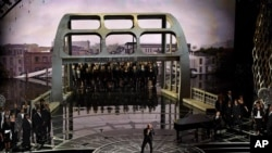 Common and John Legend perform at the Oscars with the Edmund Pettus Bridge on the set.