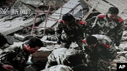Frame grab taken off Chinese state CCTV shows Chinese military searching through the rubble of collapsed buildings following a strong earthquake in Yushu County in northwest China's Qinghai province, 14 Apr 2010