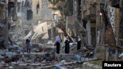 Salah satu sudut wilayah Deir al-Zor, pasca serangan bentrokan antara pasukan pemerintah dan pemberontak Suriah (Foto: dok). Human Right Watch dalam laporannya mengungkapkan adanya unsur kesengajaan dalam serangan terhadap warga sipil di Suriah, Kamis (11/4).