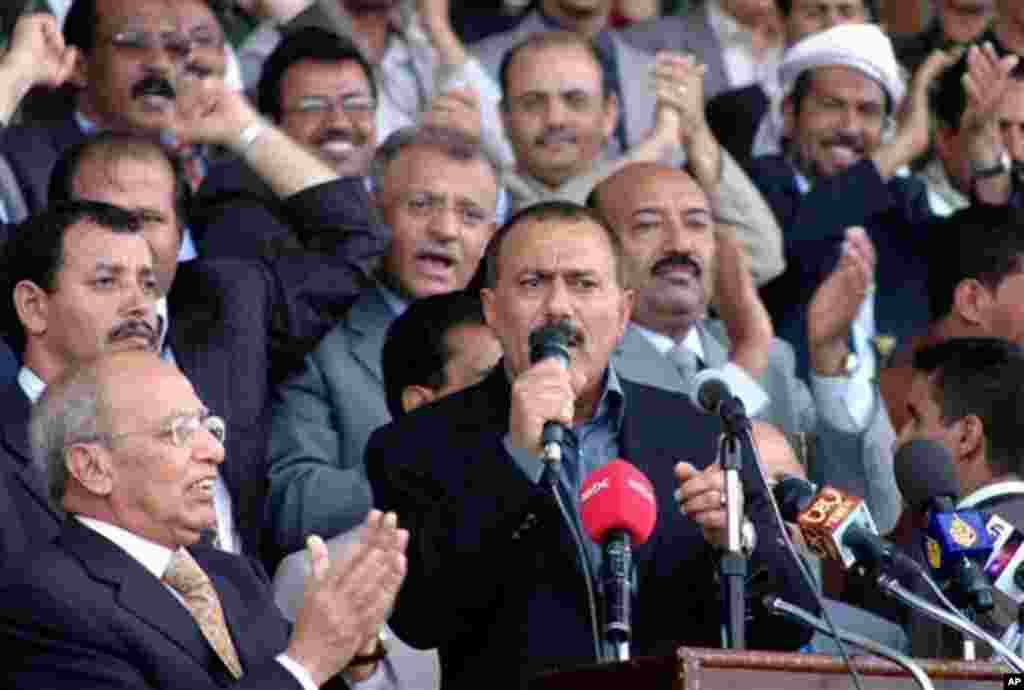Yemeni President Ali Abdullah Saleh, center, talks to his supporters outside the stadium where Saleh's General Congress Party held a convention to nominate its candidate for the polls, in the capital Sana'a, Yemen, Saturday, June 24, 2006. Saleh who has r