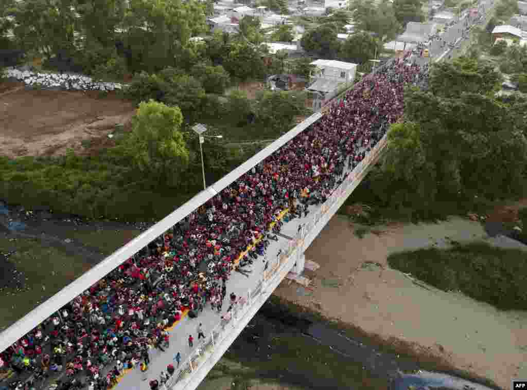 Central American migrants - mostly Hondurans, travelling on caravan to the U.S - remain at the international bridge that connects Tecum Uman, Guatemala, with Ciudad Hidalgo, Mexico.