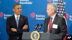 President Barack Obama is introduced by W. James McNerney, Jr., CEO of Boeing (R), before speaking to members of the Business Roundtable, a trade group representing America's big businesses, in Washington, Sept. 18, 2013.