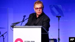 """Elton John speaks at the Elton John AIDS Foundation's 14th Annual """"An Enduring Vision"""" Benefit at Cipriani Wall Street on Nov. 2, 2015, in New York."""