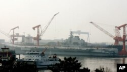 China's first aircraft carrier, the former Soviet carrier Varyag, which China bought from Ukraine in 1998, at the port of Dalian, in northeast China's Liaoning province, August 4, 2011.