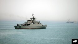 In this picture taken on April 7, 2015, and released by the semi-official Fars News Agency, Iranian warship Alborz, is seen in the Strait of Hormuz.