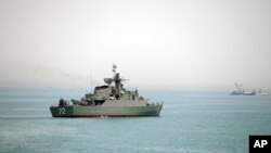 In this picture taken on April 7, 2015, and released by the semi-official Fars News Agency, Iranian warship Alborz, is seen in the Strait of Hormuz. Tehran has threatened to close the waterway to U.S. and allied vessels.