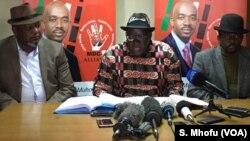 FILE: Tendai Biti (center) of the Movement for Democratic Change (MDC) Alliance, speak to reporters in Harare, July 12, 2018.