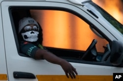 A taxi driver wearing a face mask in Kwa-Thema east of Johannesburg, South Africa.