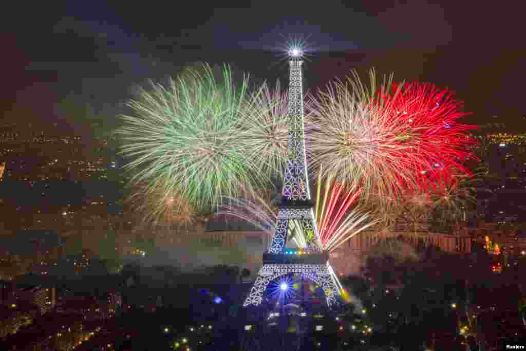 The Eiffel Tower is illuminated during the traditional Bastille Day fireworks display in Paris, July 14, 2013.