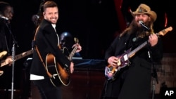 Justin Timberlake, left, and Chris Stapleton perform at the 49th annual CMA Awards at the Bridgestone Arena on Nov. 4, 2015, in Nashville, Tenn.