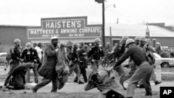 FILE - Alabama state troopers use clubs against voting rights marchers in Selma on March 7, 1965. At foreground right, John Lewis, chairman of the Student Nonviolent Coordinating Committee, is beaten. That 'Bloody Sunday' spurred passage of the Voting Rig