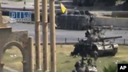 Military armored vehicles are seen in the central city of Hama, Syria, August 1, 2011