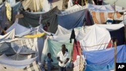 A camp of makeshift tents sprawls at Port-au-Prince's golf course, where many Haitians displaced by the earthquake have set up shelter, 25 Jan 2010