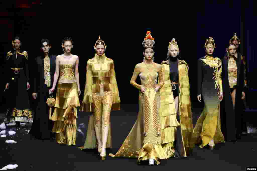 Models present creations at the Heaven Gaia by Xiong Ying show during the China Fashion Week in Beijing, Oct. 30, 2019.