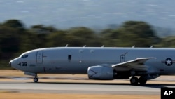A U.S. Navy P-8 Poseidon takes off from Perth Airport on route to rejoin the on-going search operations for the missing Malaysia Airlines Flight 370 in Perth, Australia, Apr. 10, 2014.