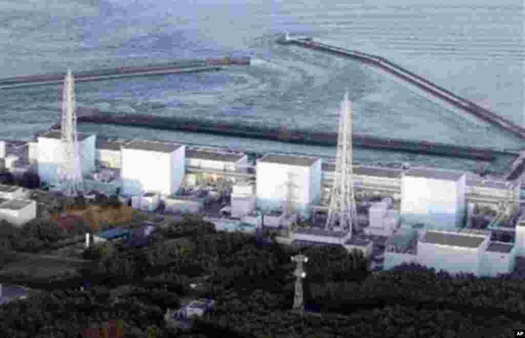 Fukushima Daiichi power plant's Unit 1 is seen in Okumamachi, Fukushima prefecture, Japan, Friday, March 11, 2011. The nuclear power plant affected by a massive earthquake is facing a possible meltdown, an official with Japan's nuclear safety commission s