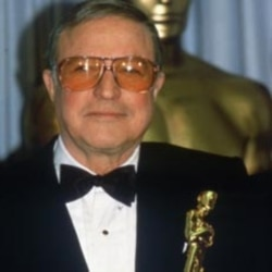 Gene Kelly receives an Oscar at the Academy Awards in 1984 to replace the one he lost when fire destroyed his home in 1983