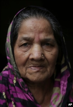 Akhtari Begum, 88, poses for the Associated Press in Lahore, Pakistan, July 31, 2017. Begum was spared many of the horrors that haunt Partition survivors thanks to the Hindu villagers who hid her away from marauding mobs and kept her safe.