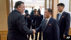 U.S. Secretary of State Mike Pompeo meets with Kim Yong Chol, second from right, a North Korean senior ruling party official and former intelligence chief, for a second day of talks at the Park Hwa Guest House in Pyongyang, North Korea, Saturday, July 7, 2018.