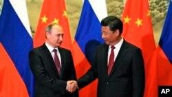 2016年6月25日中国国家主席习近平在北京会晤到访的俄罗斯总统普京。