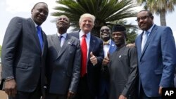 President Trump poses with, from left, Kenyan President Uhuru Kenyatta, African Union President Alpha Conde', African Development Bank President Akinwumi Adesina, Nigerian Vice President Yemi Osinbajo, and Ethiopian PM Haile Mariam Desalegn, in Taormina, Italy.