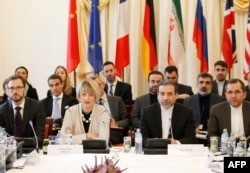 The Joint Commission members of the Joint Comprehensive Plan of Action (JCPOA), are pictured during their first meeting Oct. 19, 2015, at Palais Cobourg in Vienna, Austria.