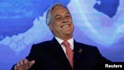 """El presidente de Chile, Sebastián Piñeira, pidió a los millones de votantes que salgan a ejercer su derecho del llamado """"voto voluntario""""."""