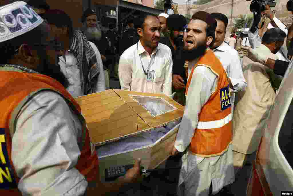 Relatives and rescue workers carry the coffin of a man, who was killed in a bomb blast, at a hospital in Peshawar, Oct. 7, 2013.
