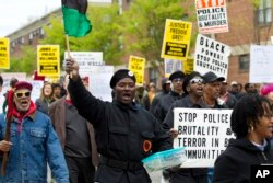 FILE - Demonstrators protest in the streets as they march for Freddie Gray to Baltimore's City Hall, in Baltimore, April 25, 2015.