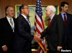 U.S. Defense Secretary Ash Carter, second left, meets with U.S. Senator John McCain on the sidelines of the IISS Shangri-La Dialogue in Singapore, June 3, 2016.