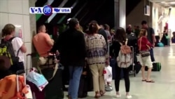 VOA60 America - Chaos at Florida Airport After Spirit Flights Canceled