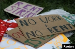 FILE - Signs lay on the ground after people gathered outside of an apartment complex to protest the eviction of one of the tenants in Mount Rainier, Maryland, August 10, 2020.