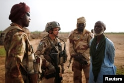 FILE - Malian Armed Forces and French soldiers conduct an area control operation in the Gourma region during Operation Barkhane in Ndaki, Mali, July 29, 2019.