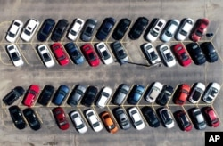Cars are parked in an auto dealer lot Wednesday, April 15, 2020, in Green Park, Mo. U.S. retail sales recorded a record drop in March, with auto sales down 25.6%, as the coronavirus outbreak closed thousands of stores and shoppers stayed home.