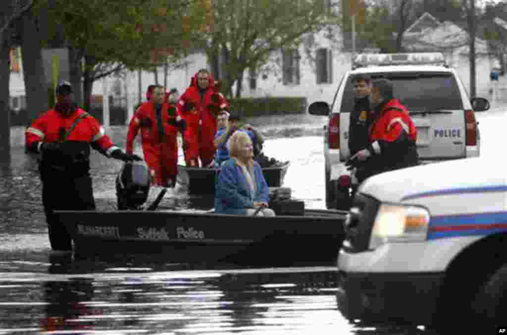 Elaine Belviso, 72, is rescued from her flooded home by Suffolk County police after being trapped there overnight by superstorm Sandy, October 30, 2012, in Babylon, New York.