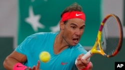 Spain's Rafael Nadal plays a shot against Serbia's Novak Djokovic in the final match of the French Open tennis tournament at the Roland Garros stadium in Paris, France, Oct. 11, 2020.
