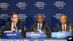 Donald Kaberuka (C) with Doug McMillon (L), Bekele Geleta at Economic Forum on Africa, in Addis Ababa, May 10, 2012.
