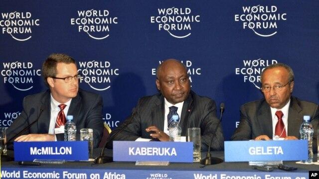Donald Kaberuka (C) with Doug McMillon (L), Bekele Geleta at Economic Forum on Africa, in Addis Ababa, May 10, 2012.