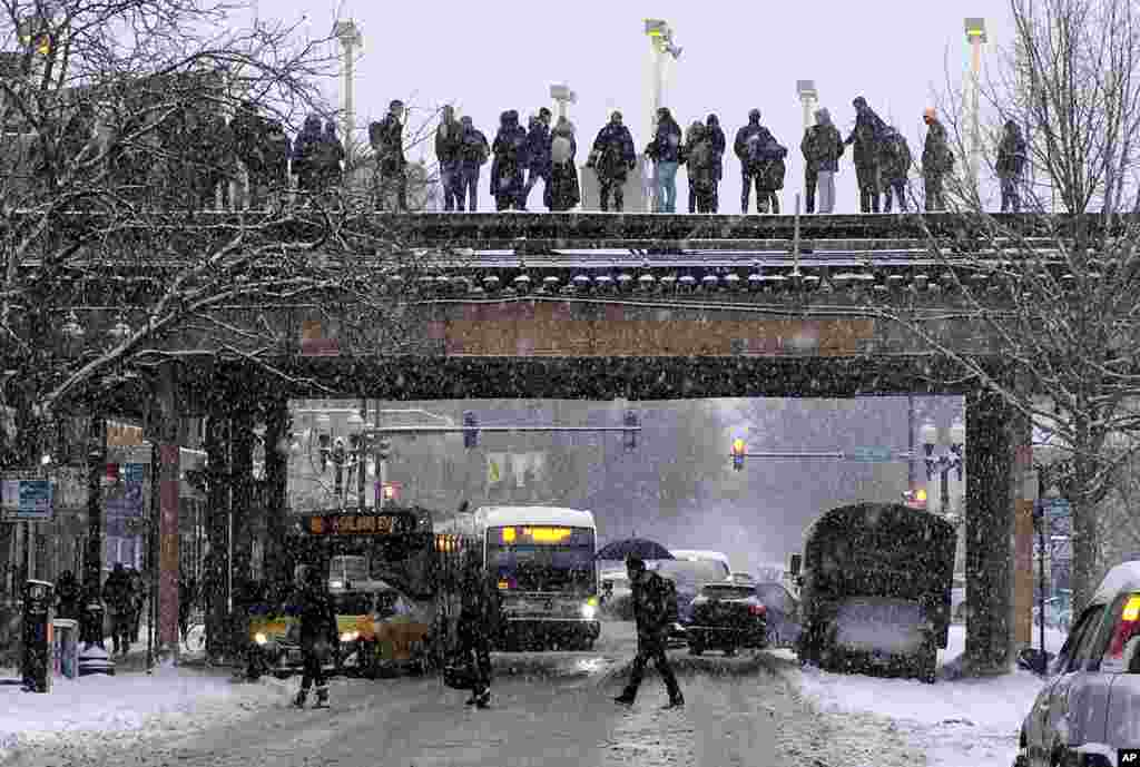"Commuters wait for a train as snow falls in Chicago, Illinois, Jan. 28, 2019. The plunging temperatures expected later this week have forecasters especially concerned. Wind chills could plunge the temperature negative 55 degrees in northern Illinois, which the National Weather Service calls ""possibly life threatening."""