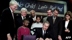 President George W. Bush signs the federal education bill known as No Child Left Behind at Hamilton High School in Hamilton, Ohio, in 2002
