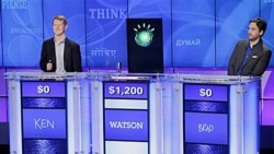 """""""Jeopardy!"""" champions Ken Jennings, left, and Brad Rutter as an IBM supercomputer named Watson sounds the buzzer first to answer a question during a practice round"""