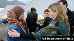 USAID Assistant Administrator Nancy Lindborg, center, talks with Syrian refugees during a recent visit to the Islahiye camp in Turkey.