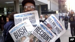In this Nov. 8, 2000 file photo, newspaper headlines reflect the suspense, drama and changes in following the presidential race between Vice President Al Gore and Texas Gov. George W. Bush.