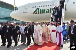 In this image provided by L'Osservatore Romano, Pope Francis arrives in Yangon, Myanmar, Nov. 27, 2017.