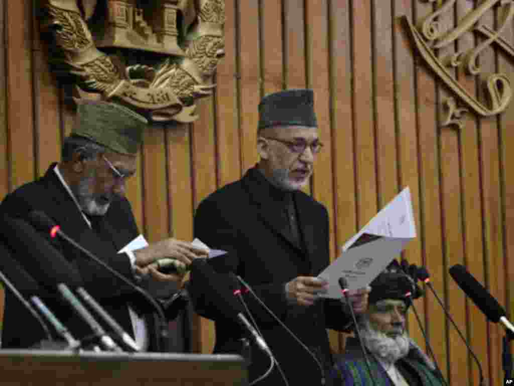 Afghan President Hamid Karzai gives an oath to members of the new parliament in Kabul, January 26, 2011. Karzai opened parliament on Wednesday, ending a standoff with lawmakers, but setting the stage for a longer battle against an assembly he has long ig